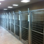 Dog and Cat Kennels     In our 2500 sq.ft. indoor boarding facility, dogs and cats are kept in separate areas which are heated and cooled for maximum comfort. Boarding facility sizes range from medium cages to spacious suites.